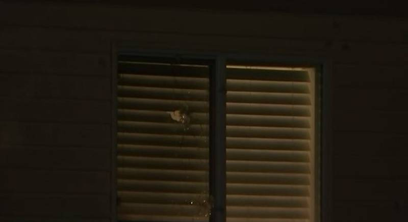Woman inside home hit in drive-by shooting
