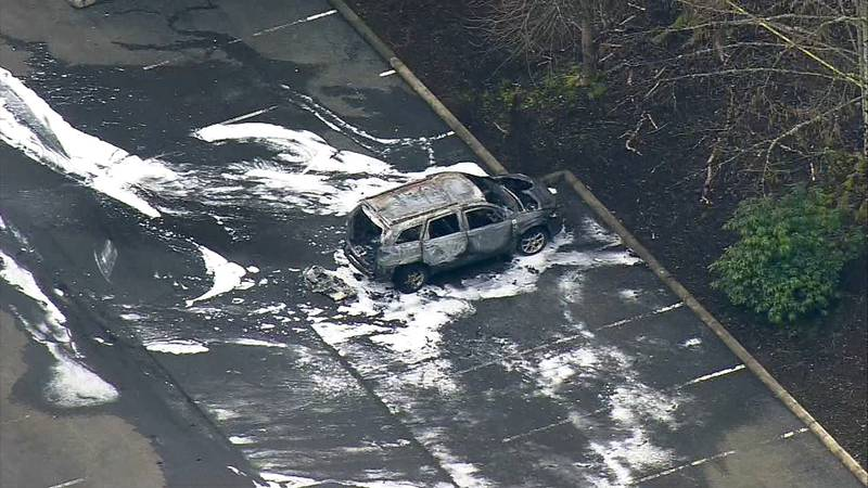 Photo of a burned out car where a body was found inside.