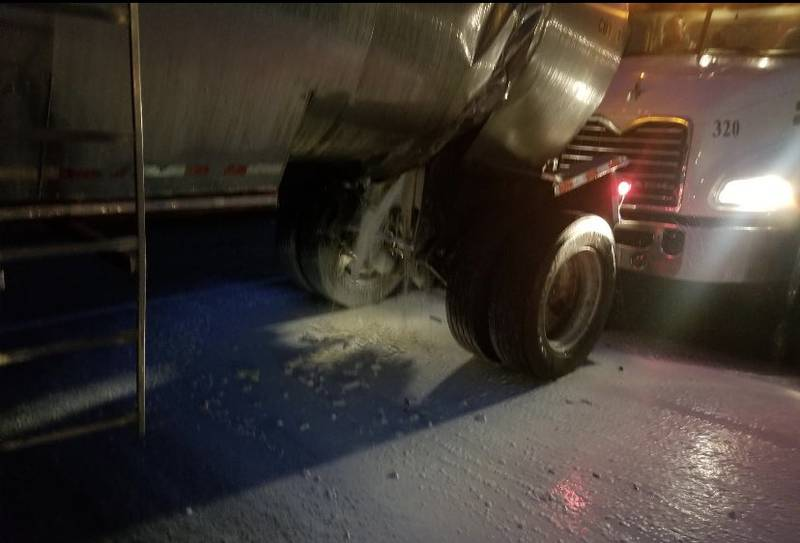 One semi truck had a load of milk or cream, which spilled onto the freeway.