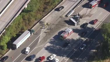 RAW: Dump truck overturns on I-5 near 405