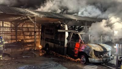 PHOTOS: Fire burns ambulances, garage in Clallam County
