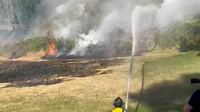 RAW: Firefighters battle brush fire in Renton