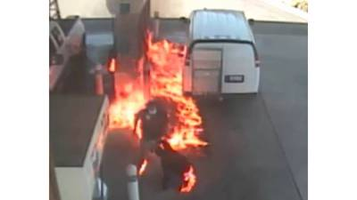 RAW: Man sprays gas on van, witnesses and gas pumps before setting fire