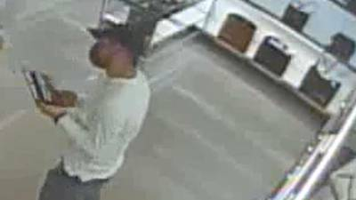 PHOTOS: Suspect in credit card theft buys high-end purses