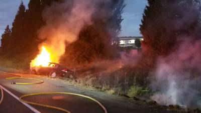 Car fire along I-5 in Fife spreads to brush, leads to mistaken report of body