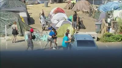 Video shows deadly confrontation between a family with a baby and a crowd at Seattle encampment